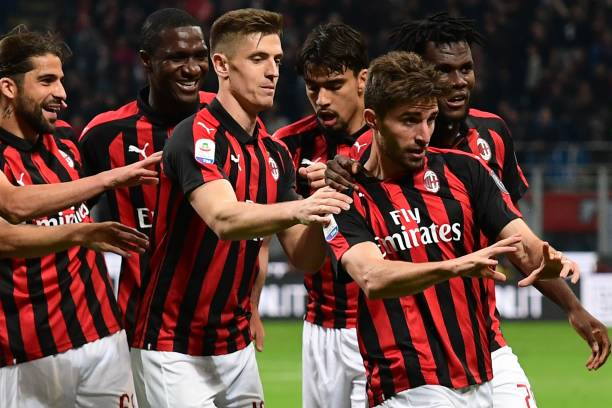 Ten-man AC Milan survive Bologna scare